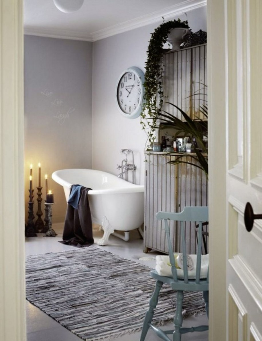 shabby-smart-bathroom-with-white-tub-and-cand