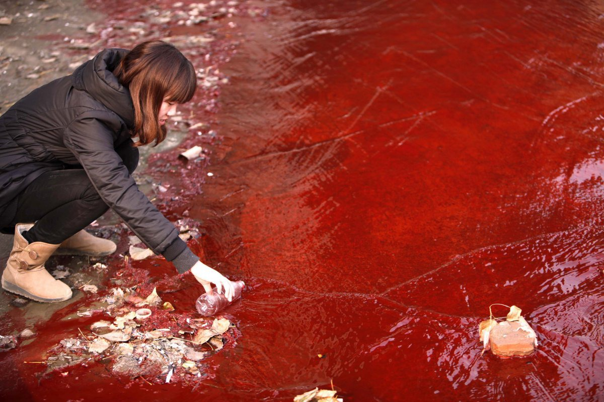 two-illegal-chemical-plants-that-were-discharging-their-production-waste-water-into-the-rain-sewer-pipes-allegedly-caused-the-jianhe-river-in-luoyang-henan-province-to-turn-red-in-december-2011